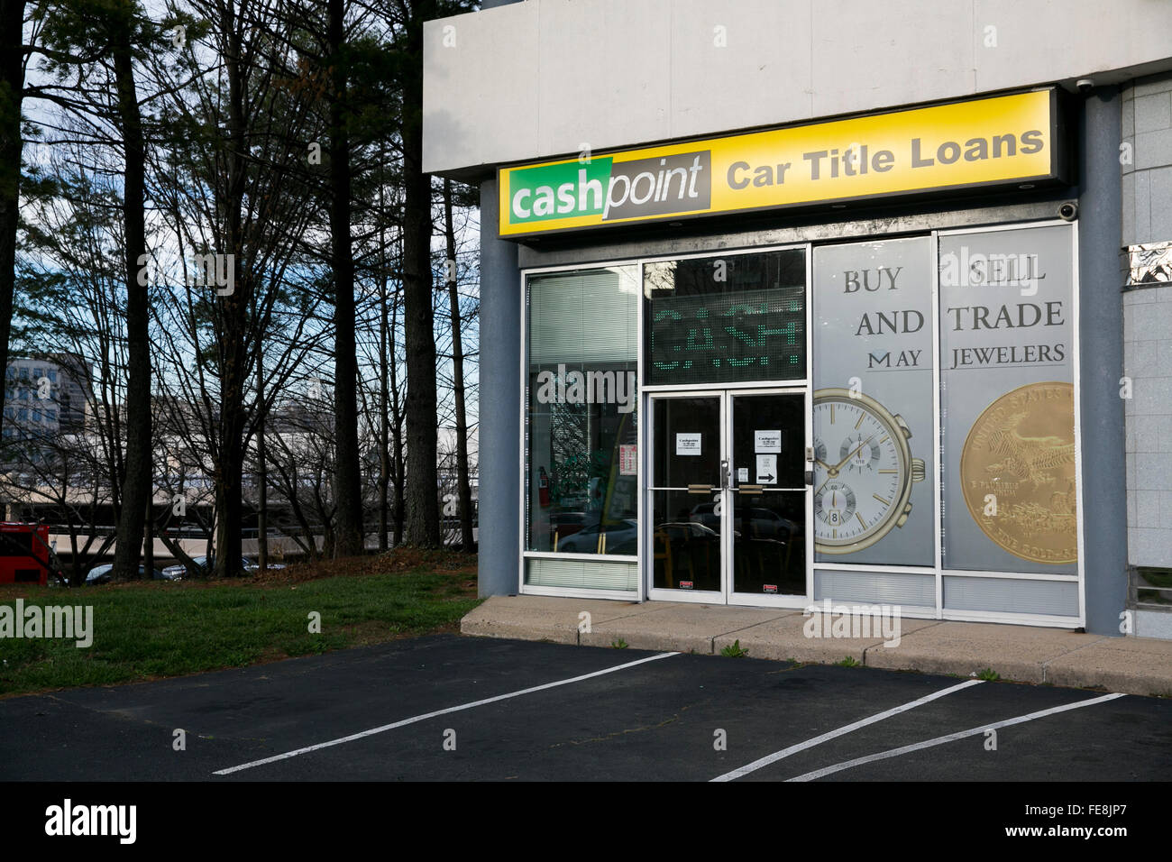 A logo sign outside of a CashPoint car title loan office in Tysons, Virginia on January 1, 2016. - Stock Image