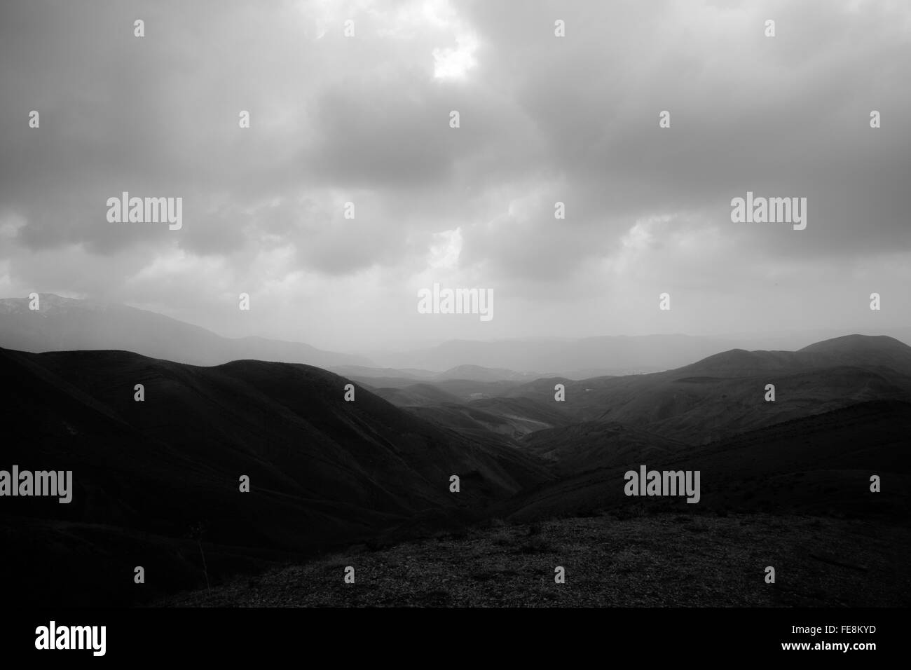 Mountain Range Landscape Against Overcast Sky - Stock Image