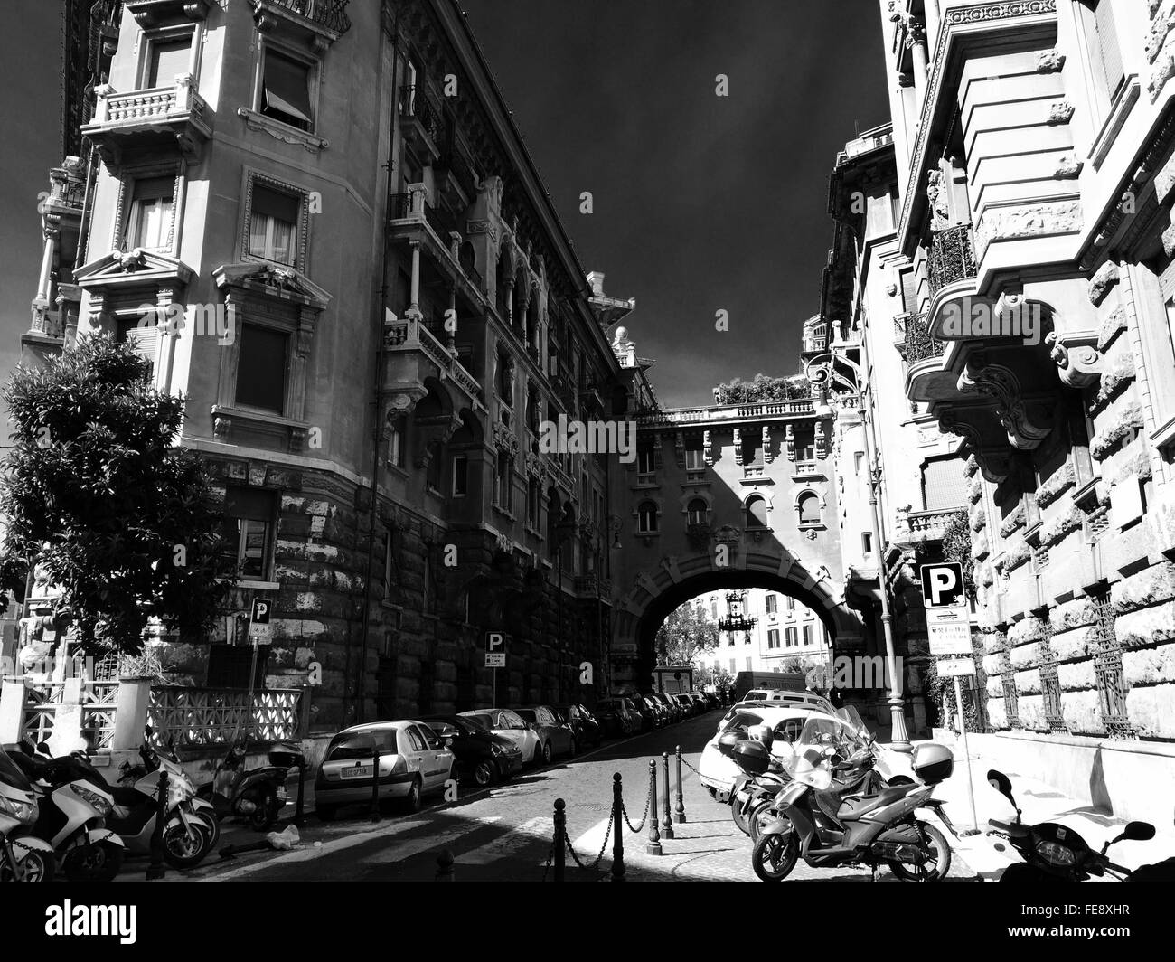 Cars Parked On Road Amidst Buildings In City - Stock Image
