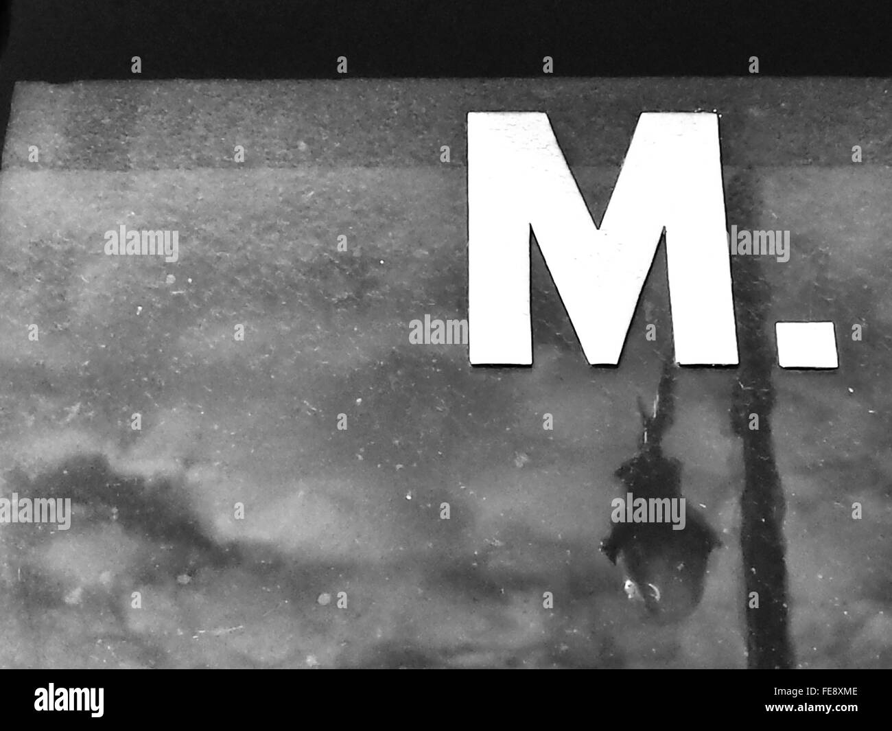 Letter M With Reflection Of Street Light In Glass - Stock Image