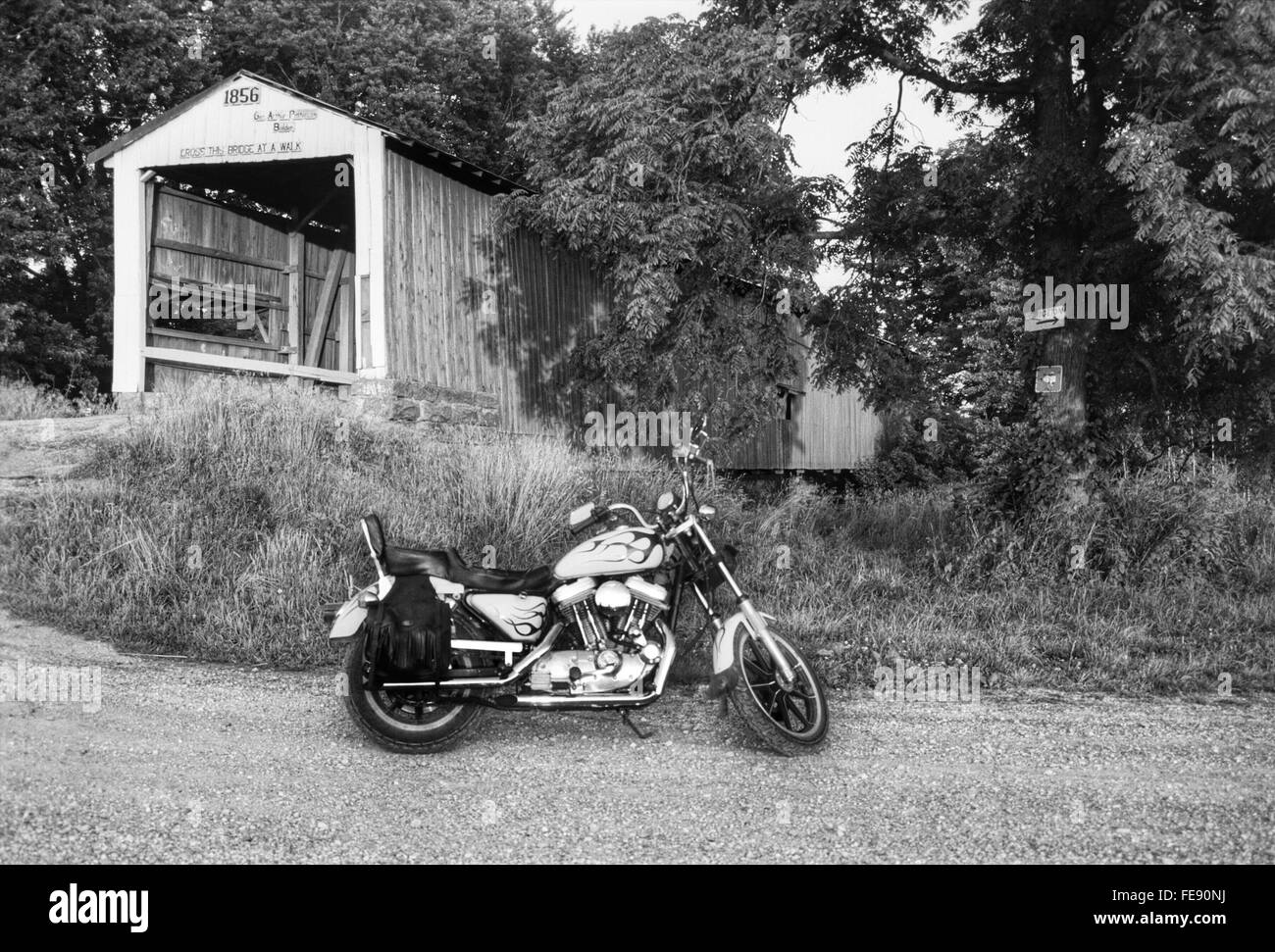 Side View Of A Motorcycle Parked By Built Structure - Stock Image