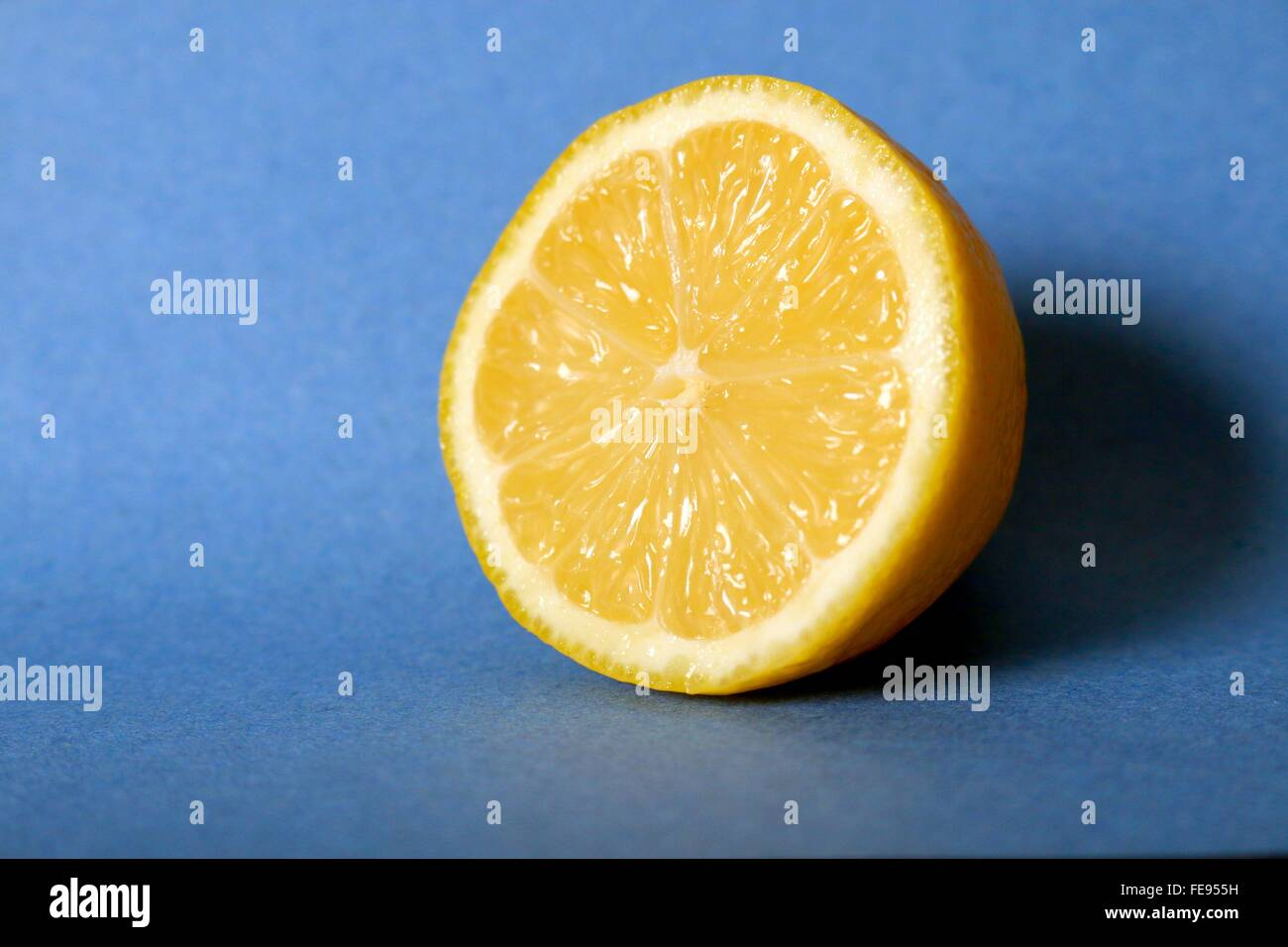 Close-Up Of Lime Against Blue Table - Stock Image