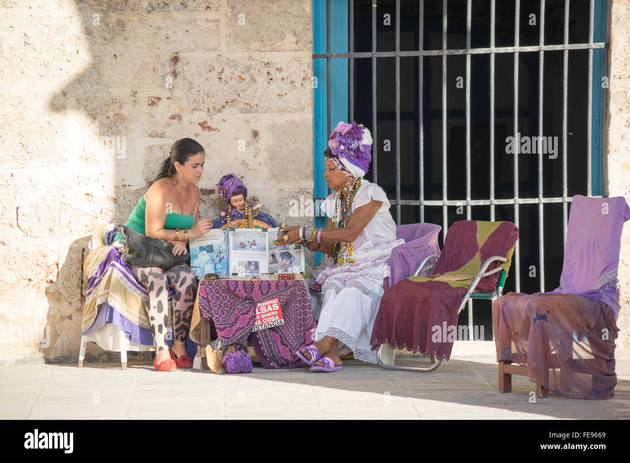 One of the fortune tellers who casts cards for tourists in Old Havana Stock Photo