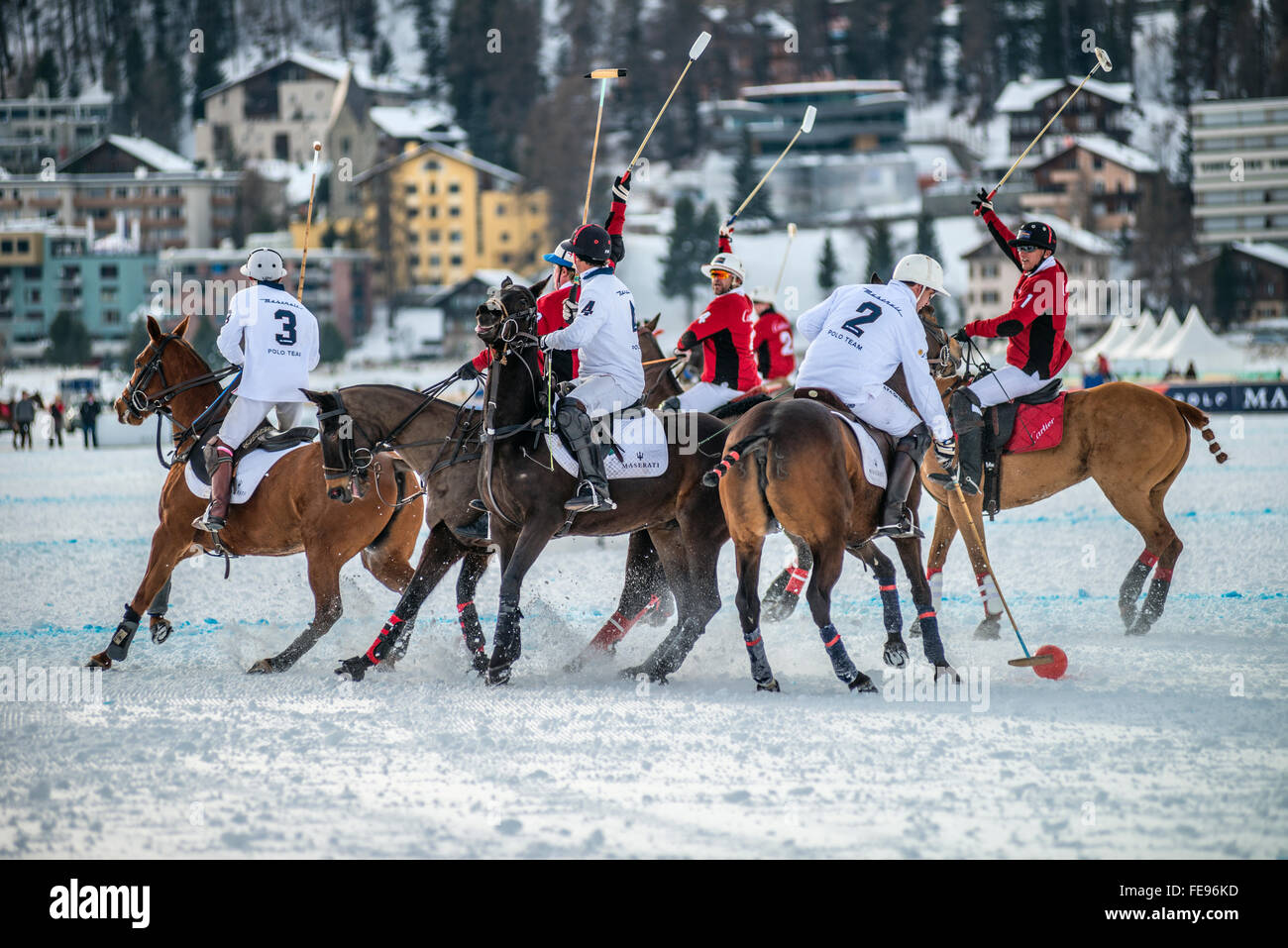 Members of the 'Cartier' team play against Team 'Maserati' during the Snow Polo World Cup 2016, - Stock Image