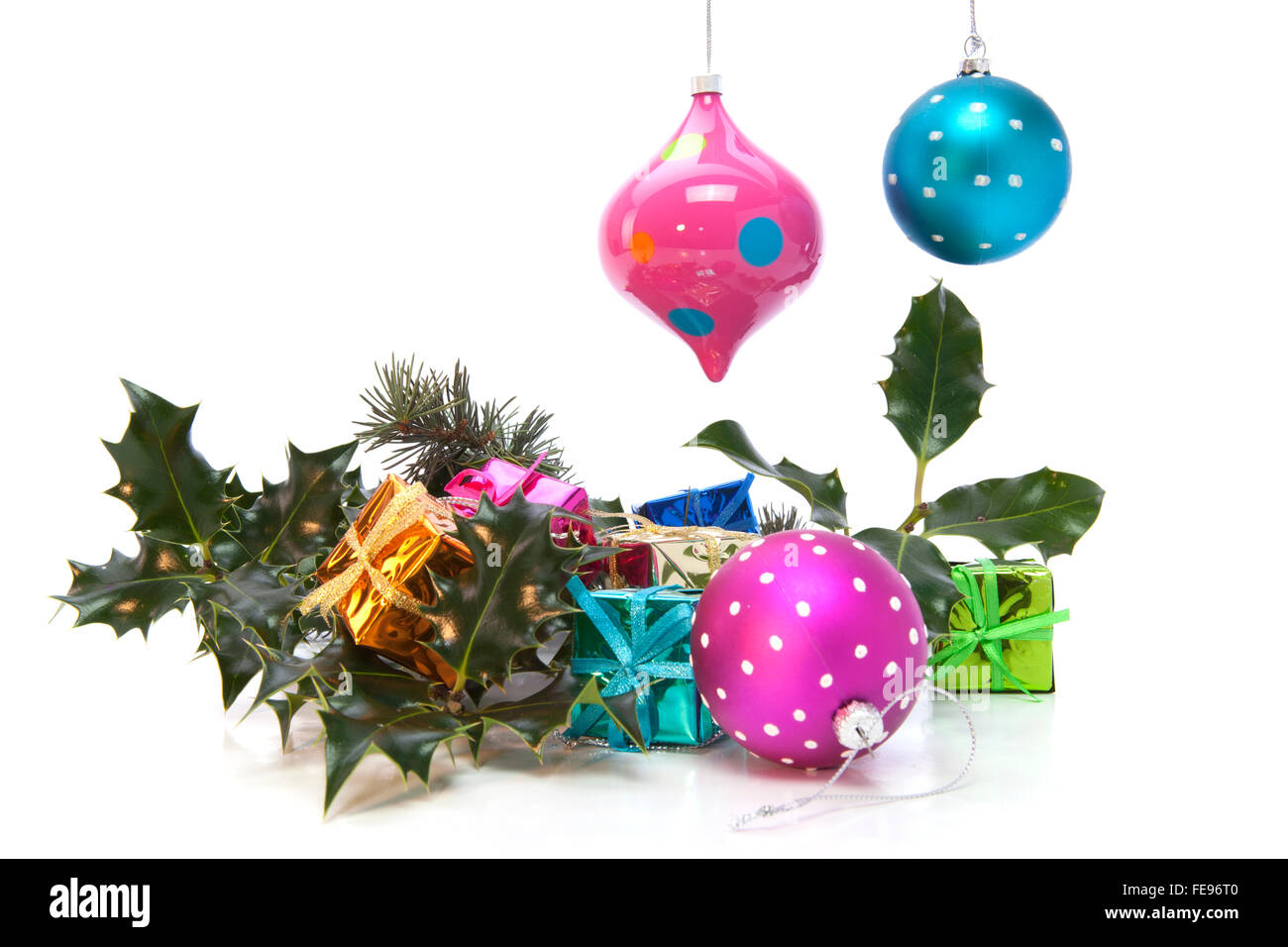 Christmas Decorations with Holly, Balls and Gifts Stock Photo