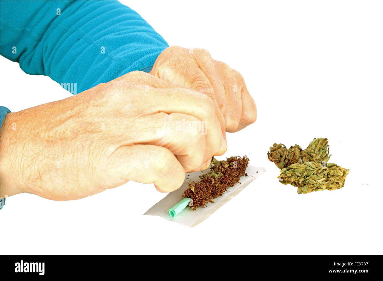 Man making a joint from marijuana - Stock Image