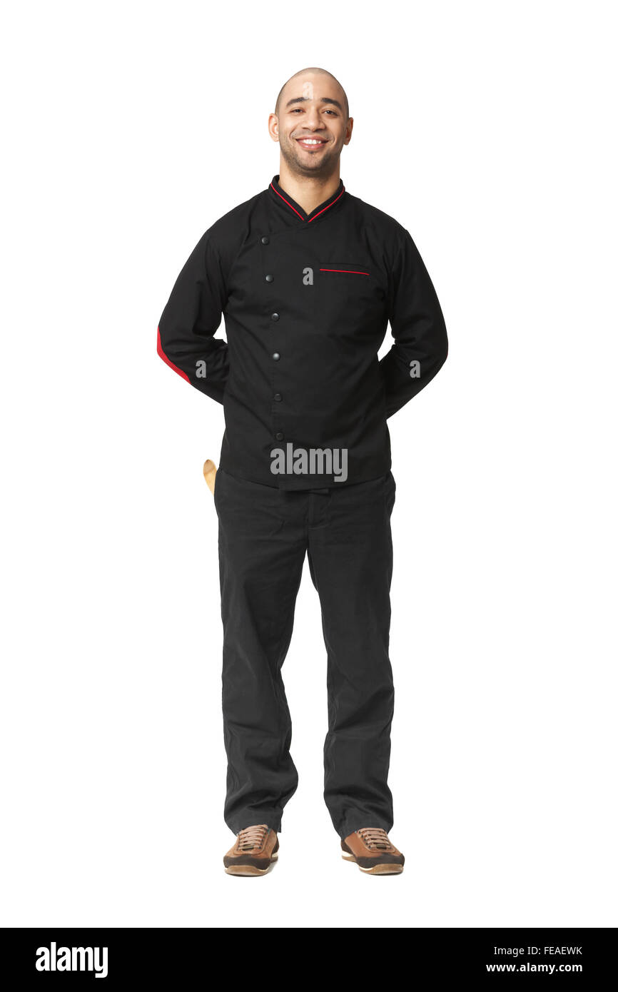 Fullbody portrait of Afro American professional cook isolated on white. - Stock Image