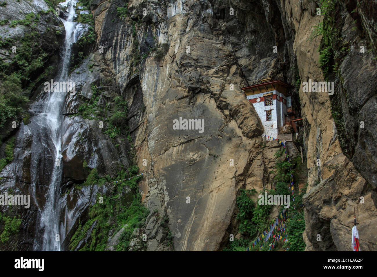 A waterfall near Taktsang monastery in Bhutan - Stock Image