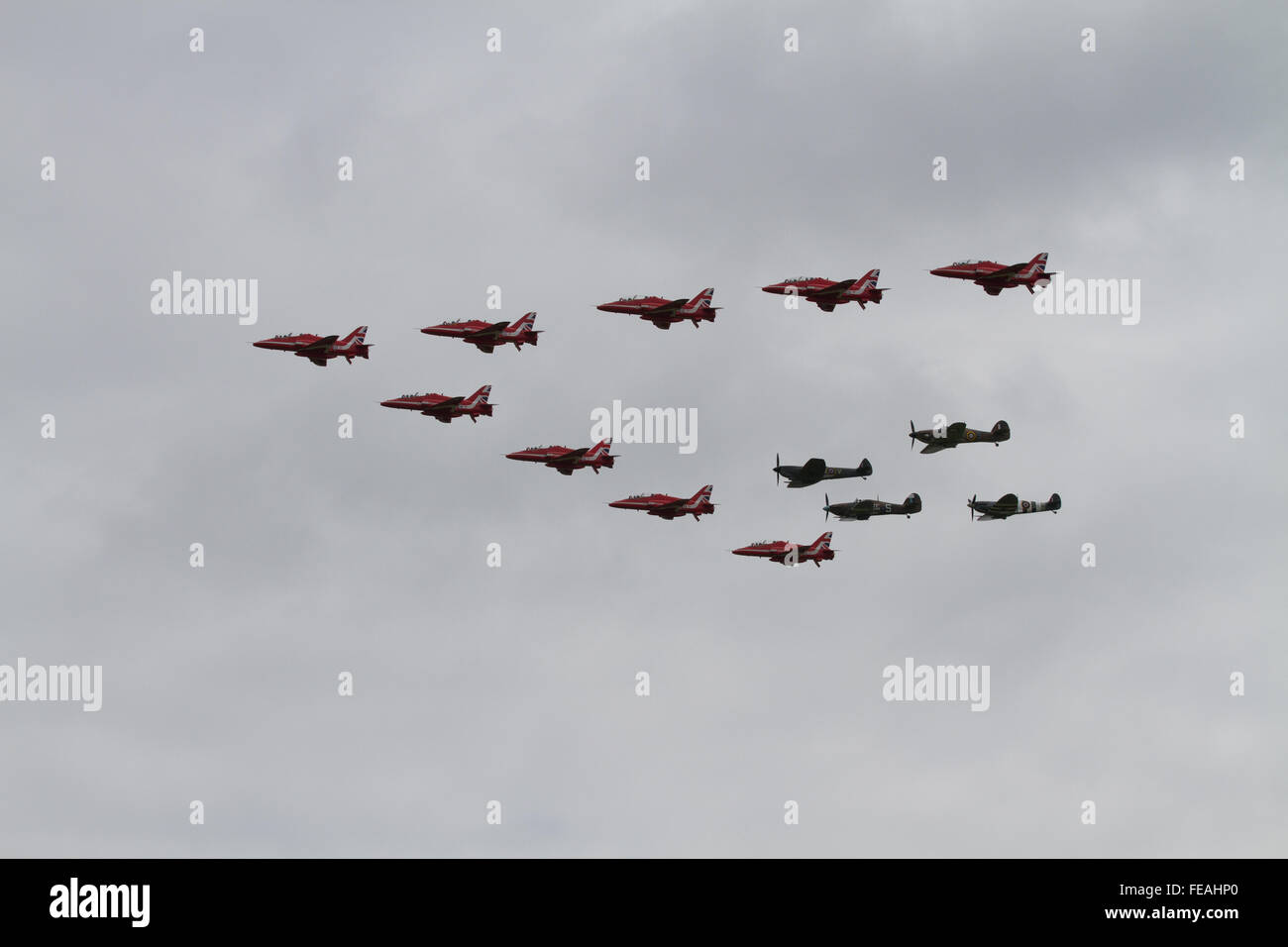 The RAF Red Arrows Display Team in formation with the Battle of Britain Memorial Flight fighters Spitfire Hurricane - Stock Image