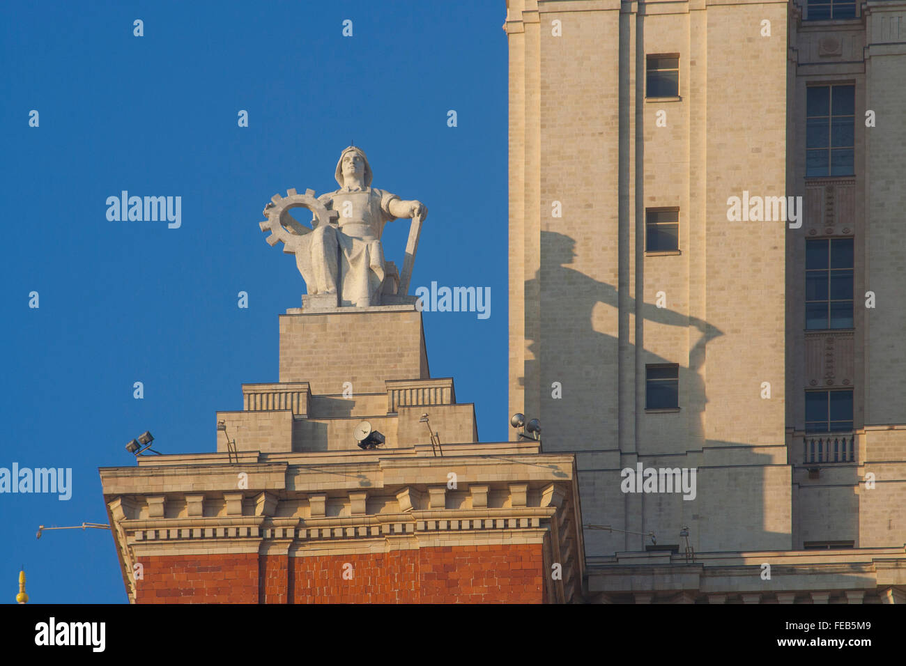 Socialist realist statue adorns the central tower of Moscow State University, one of Stalin's Seven Sisters Moscow, Russia Stock Photo