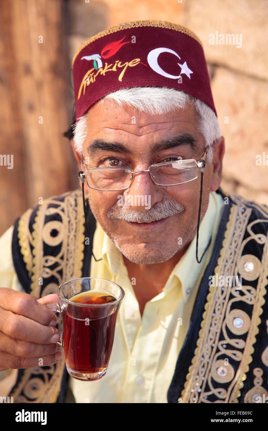 Turkish man drinking Turkish Tea in Fez, Kaleici, Antalya