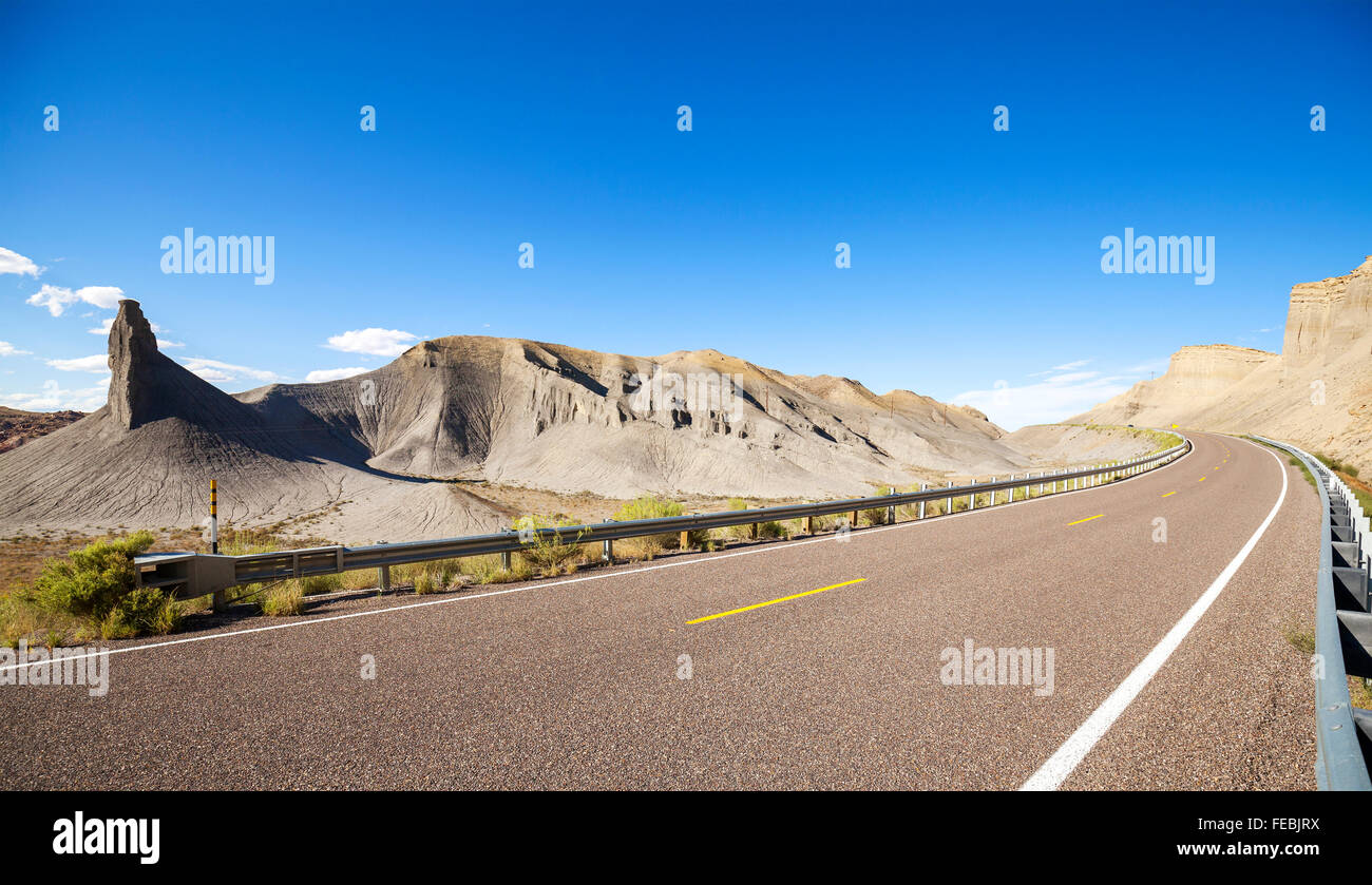 Panoramic photo of a desert road, Utah, USA. - Stock Image