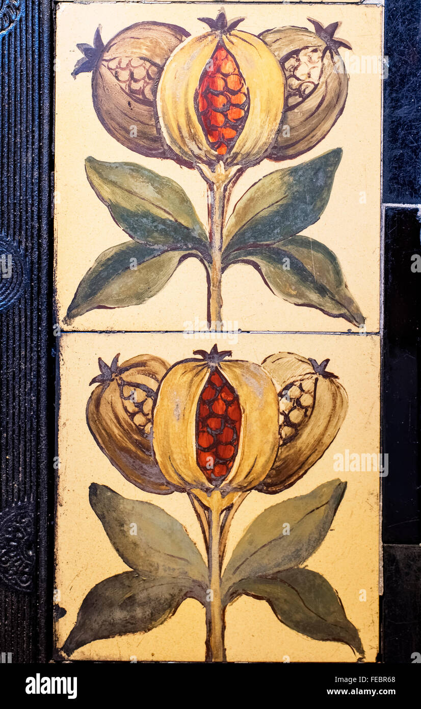 Pomegranates on decorative tiles in the former home of John Ward Knowles (artist), York, England, UK - Stock Image