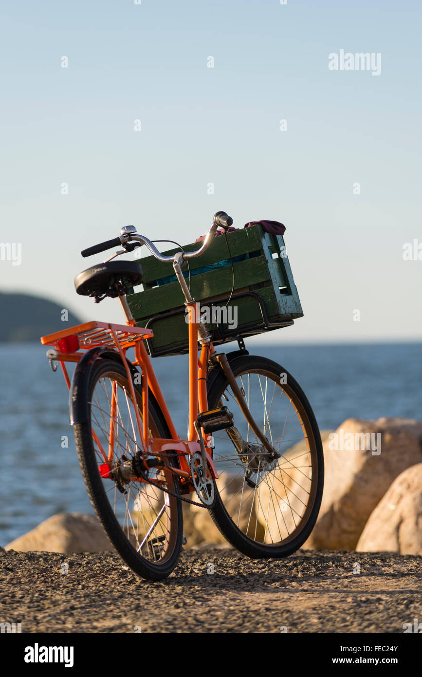 Orange Vintage Bicycle With Green Transport Box Made Of Wood In