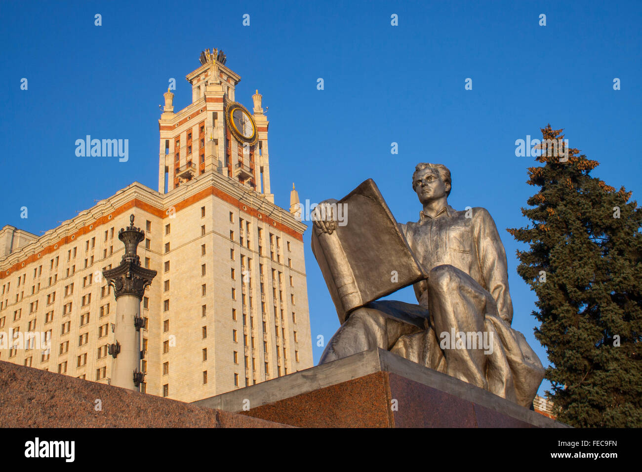 Socialist realist statue of student at Moscow State University, one of Stalin's Seven Sisters Moscow, Russia Stock Photo