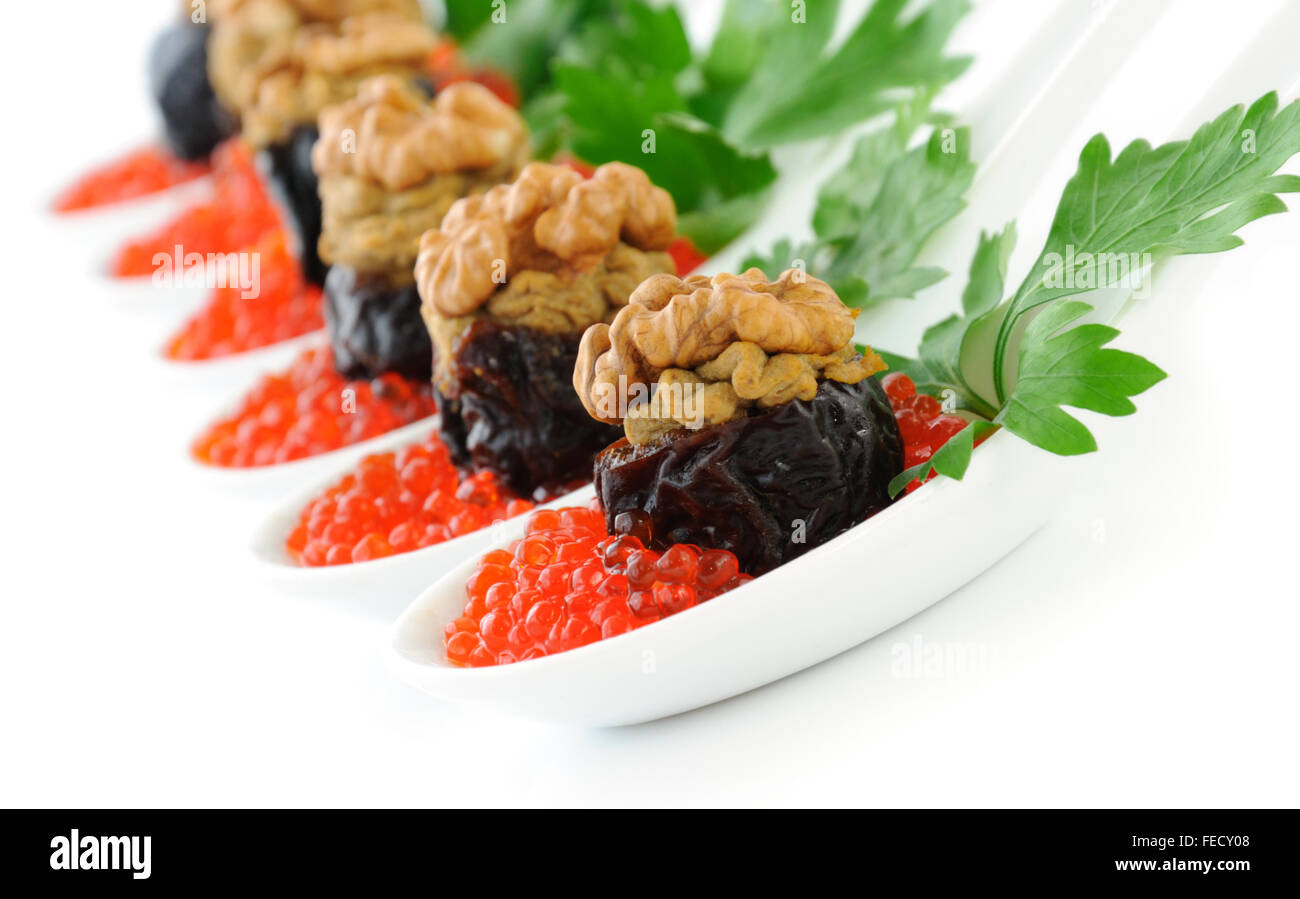 Prunes stuffed with liver pate with nuts in a red caviar - Stock Image