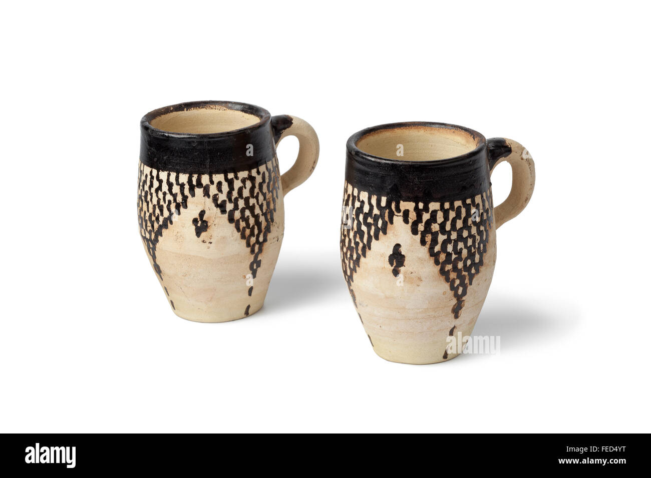 Traditional clay Moroccan water cups on white background - Stock Image