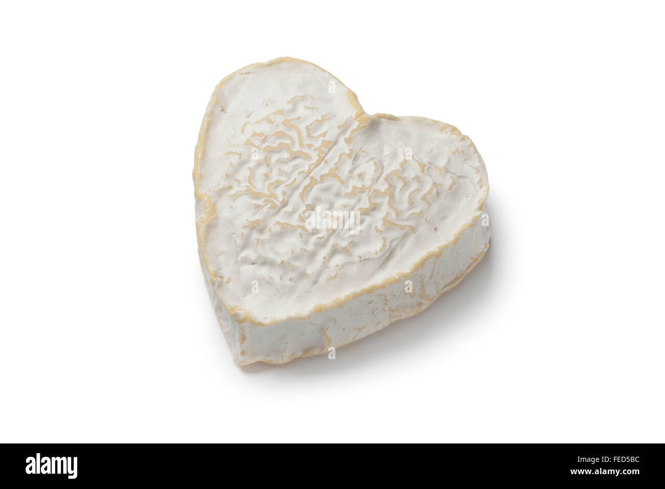 Whole Heart shaped Neufchatel cheese on white background - Stock Image