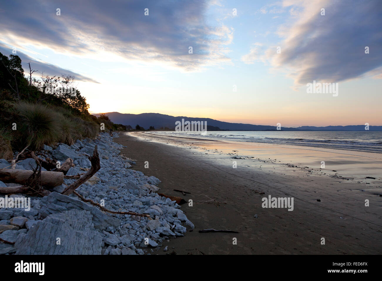 Sunset on the beach of the Marlborough Sounds New Zealand Stock Photo