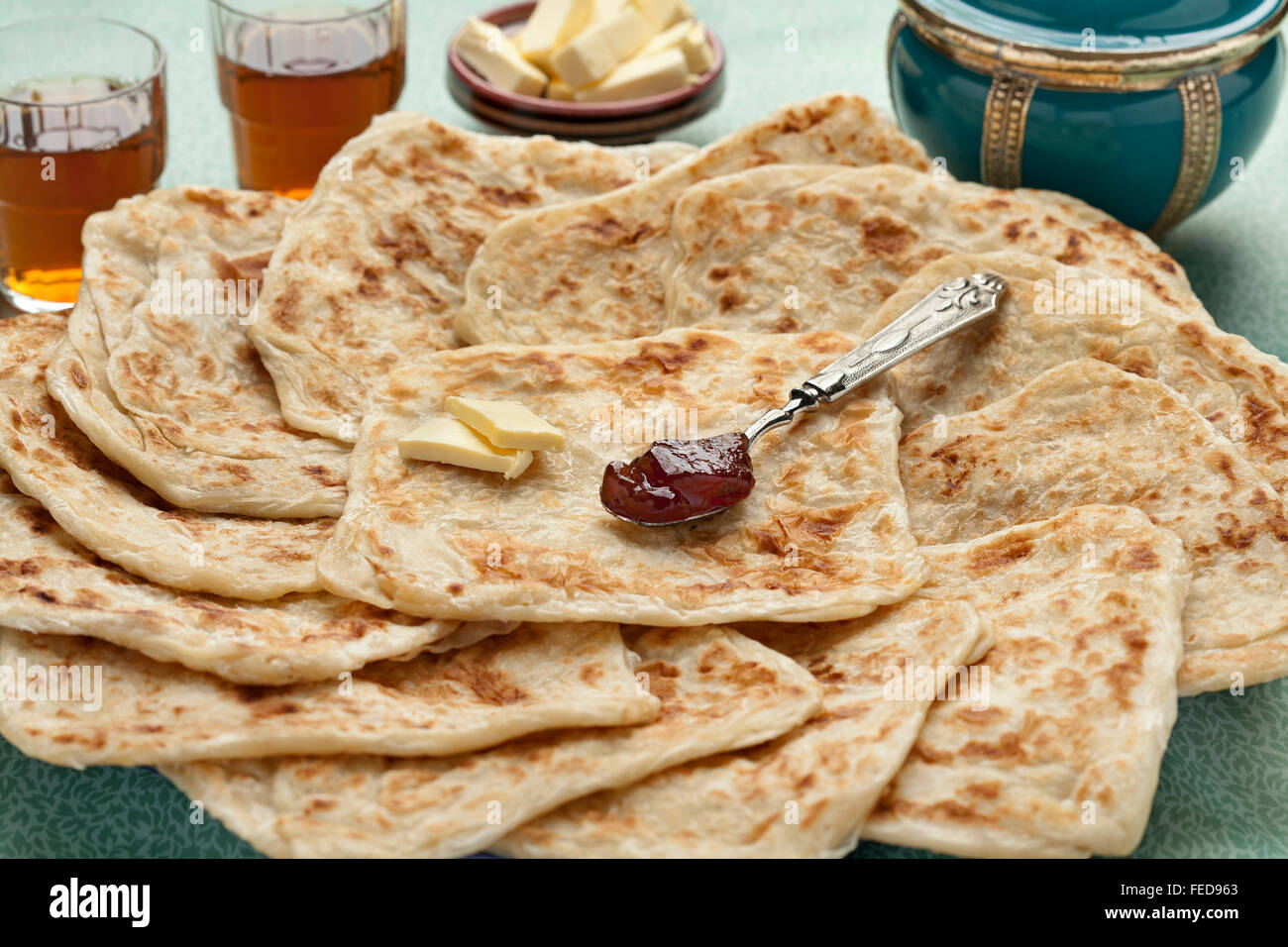 Fresh baked Moroccan square pancakes called Rghaif or Msemen with butter and jam - Stock Image