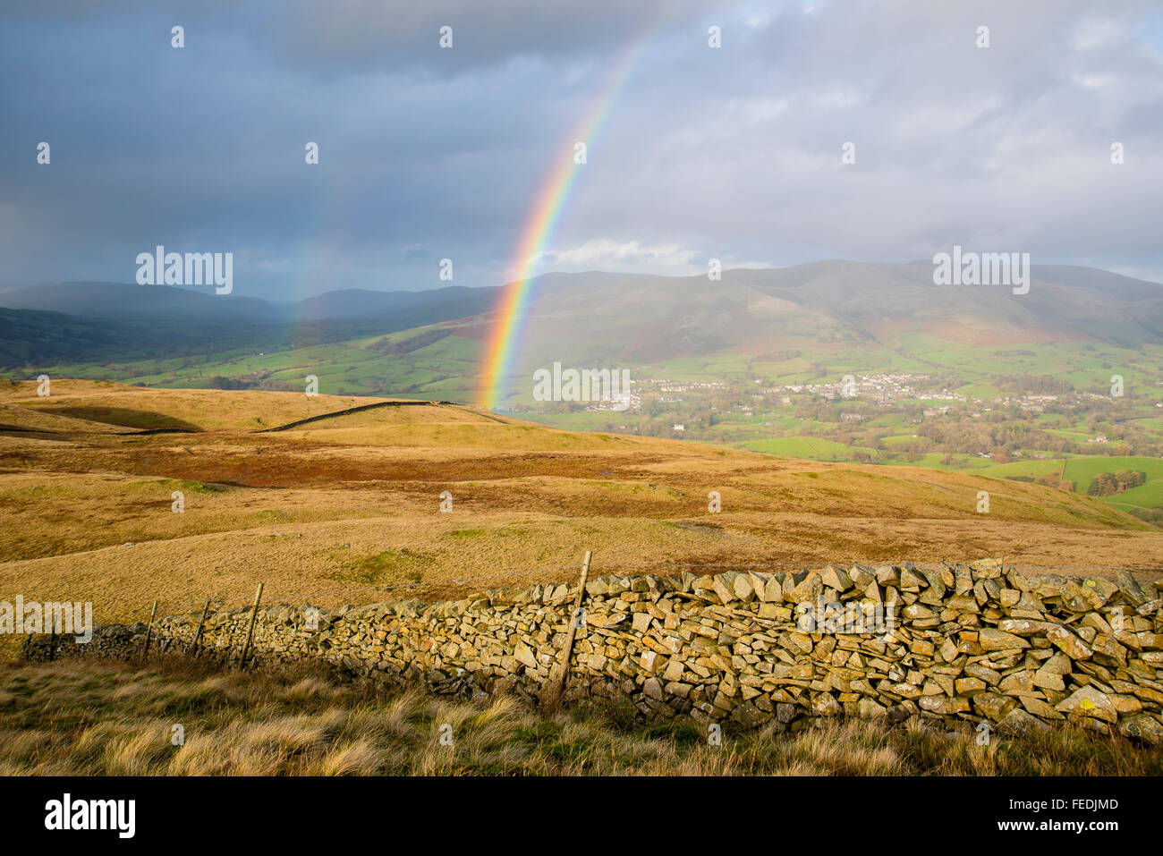 Rainbow over Sedbergh and the Howgill Fells from high on Middleton Fell Cumbria - Stock Image