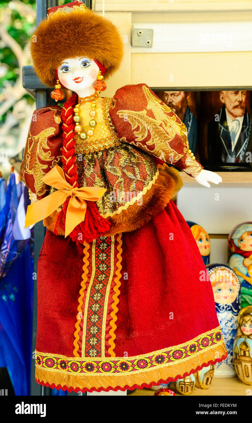 A doll in the traditional Russian costume on sale in Saint Petersburg, Russia - Stock Image