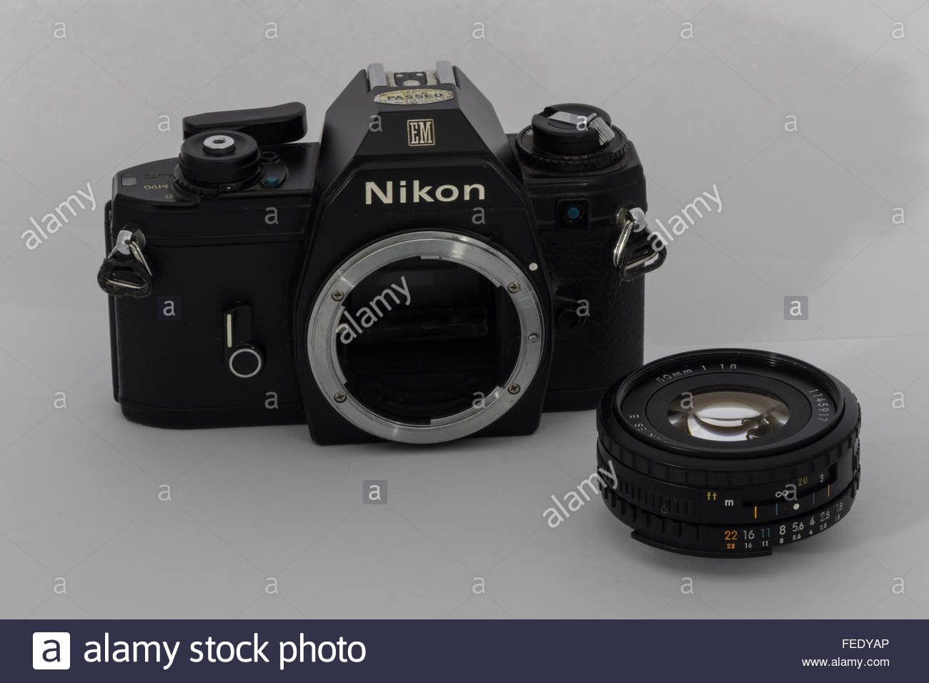 A Nikon EM 35mm SLR film SLR camera with a 50mm f1.8 'E-Series' lens. An entry-level SLR made in Japan circa - Stock Image