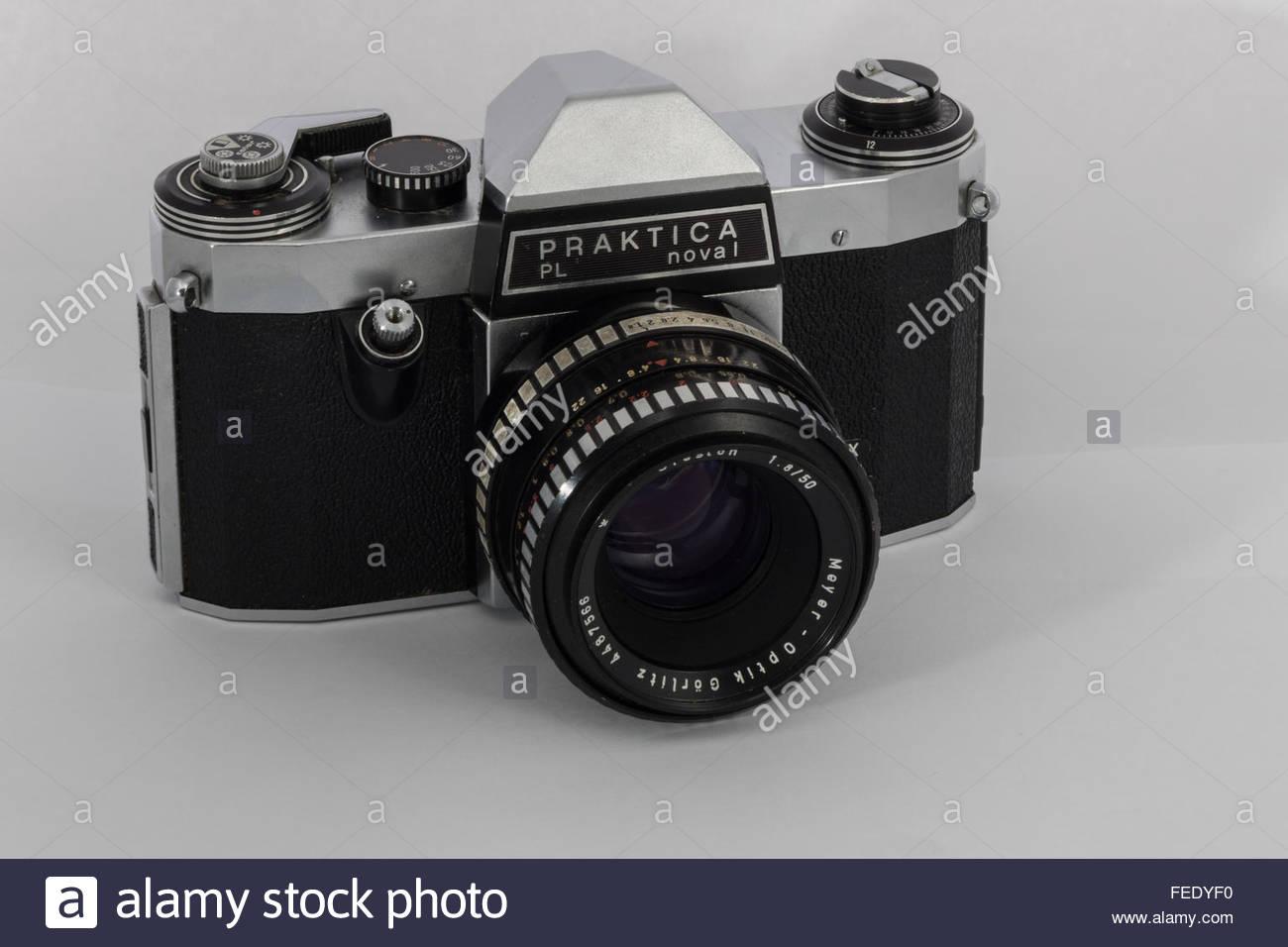 A Praktica Nova 1 a 35mm SLR film camera with a 1.8/50 Meyer-Optik Oreston lens.A 1970's entry-level SLR made - Stock Image