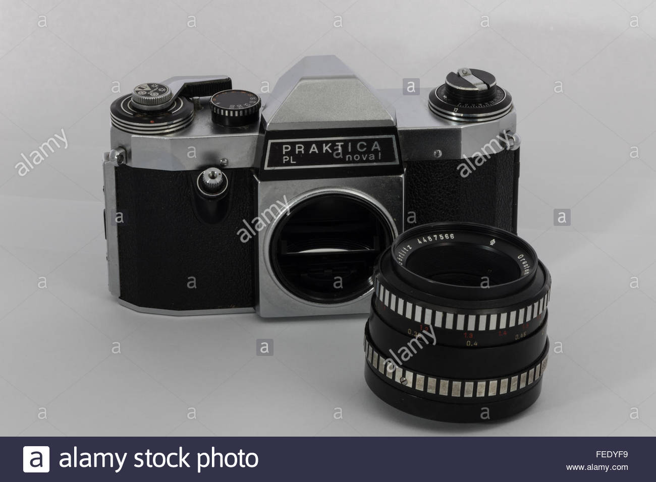 A Praktica Nova 1 a 35mm SLR film camera with a 1.8/50 Meyer-Optik Oreston lens.A 1970's entry-level SLR made - Stock Image