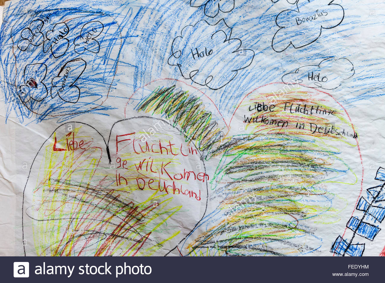 childs drawing welcoming refugees arriving from german border town of Passau in a tent at Cologne airport train - Stock Image