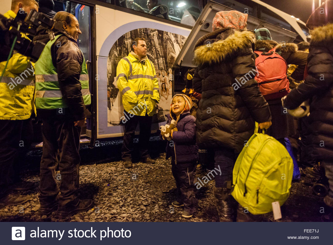 refugees arrive at Cologne airport train station on a special train from german border town Passau to start the - Stock Image