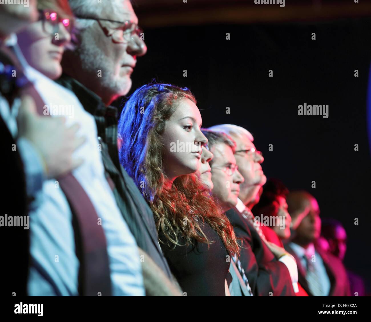 LAS VEGAS, NV - OCTOBER 13 2015: (L-R) Democratic presidential debate shows audience during opening pledge of allegiance. - Stock Image