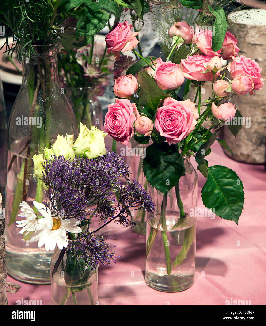 Beautiful Flower Arrangement On Table Pink Roses On Glass And Wild