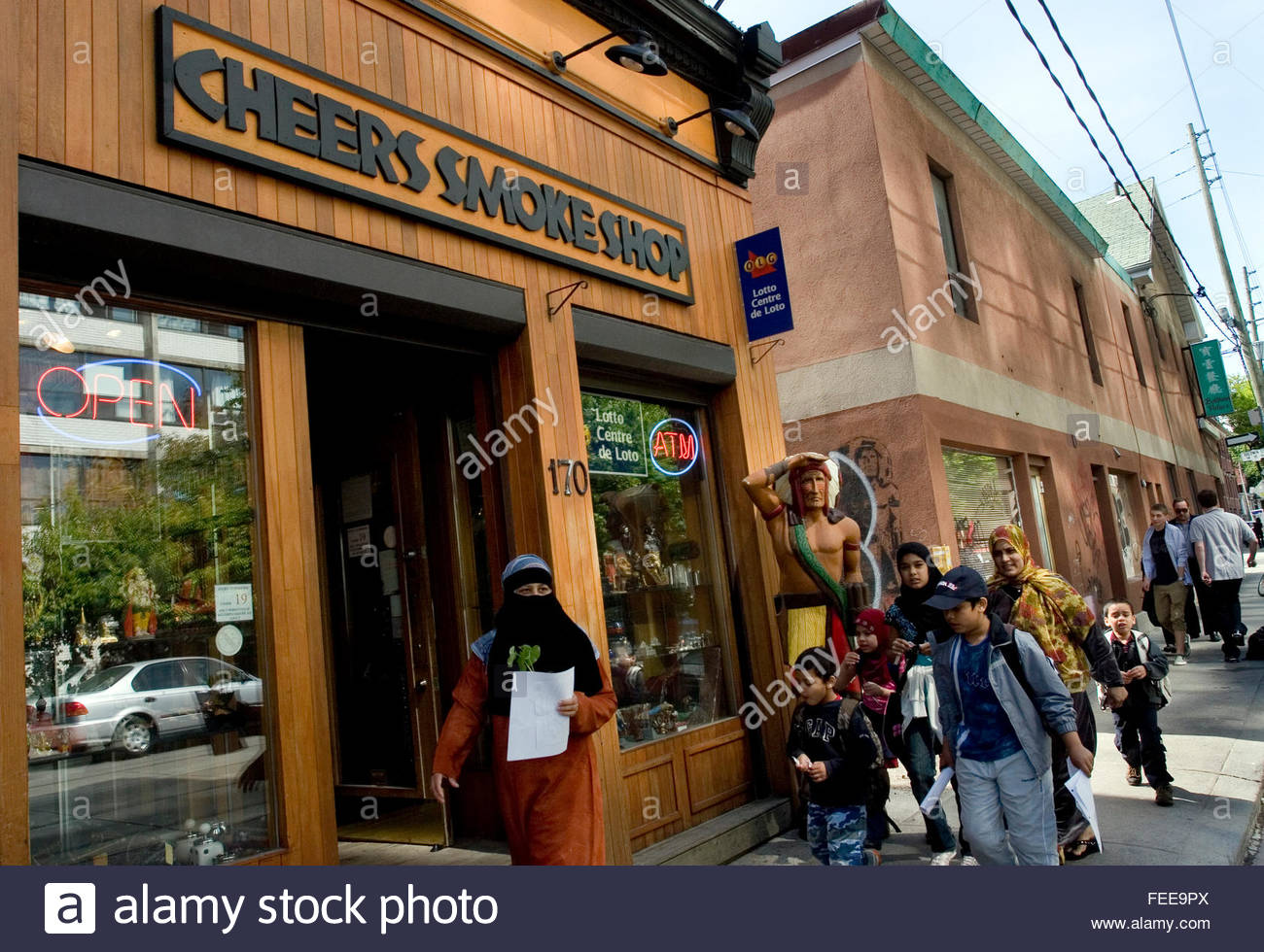 Indian Smoke Shop >> Family Group Of Children And Women In Hijab And Niqab Pass By Cigar