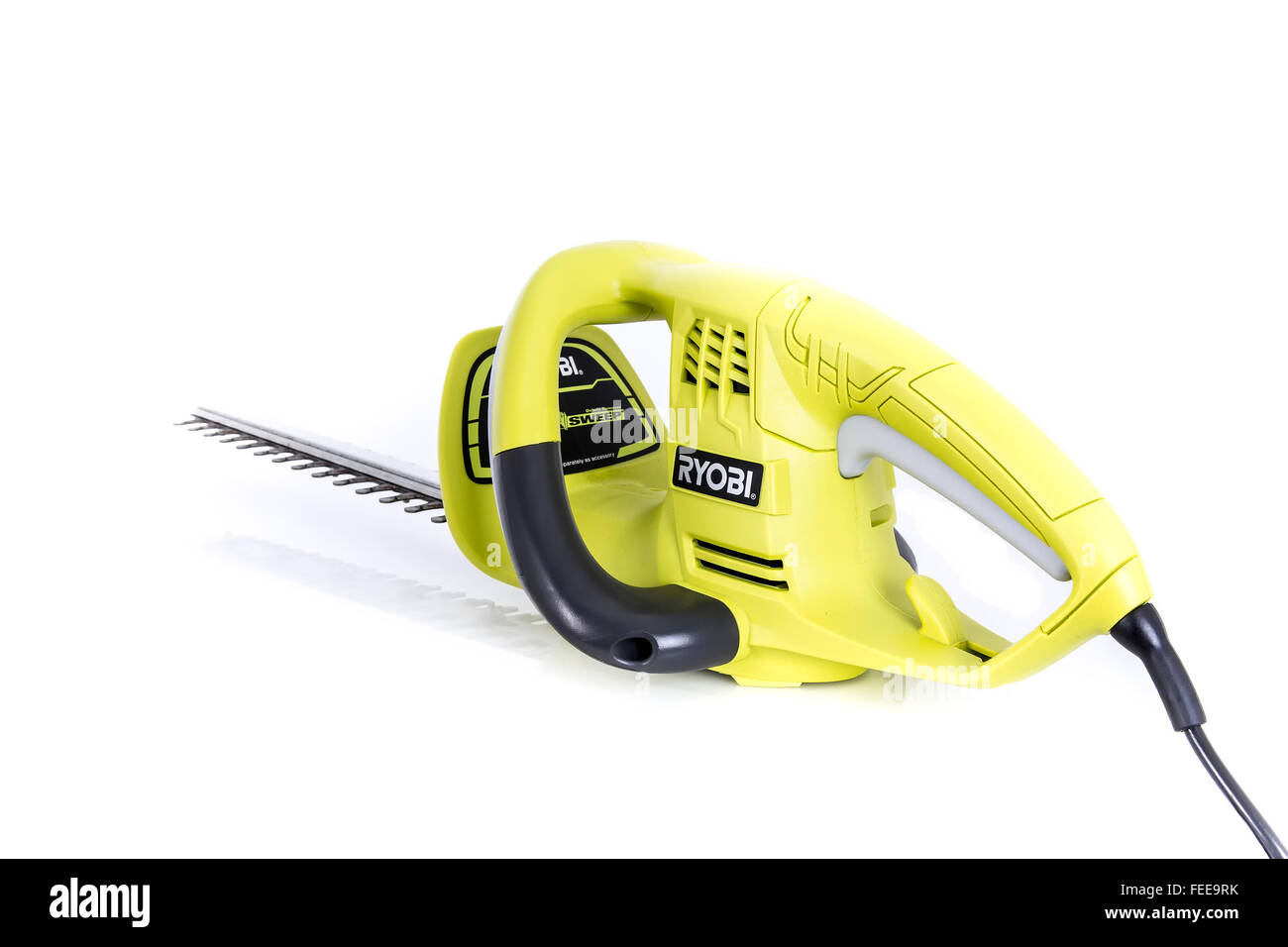 RYOBI Electric Hedge Trimmer on a White Background - Stock Image