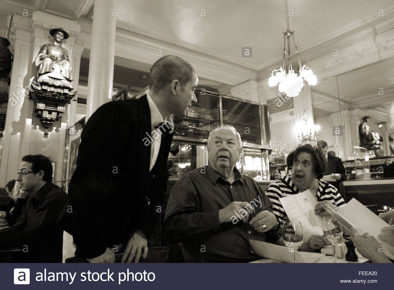 an american couple order from waiter at les deux magots cafe paris stock photo 94972248 alamy. Black Bedroom Furniture Sets. Home Design Ideas