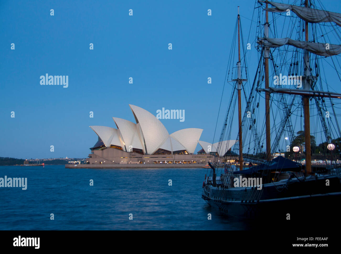 Sydney Opera House and tall ship in Campbells Cove at night dusk twilight Sydney Cove Sydney New South Wales NSW - Stock Image
