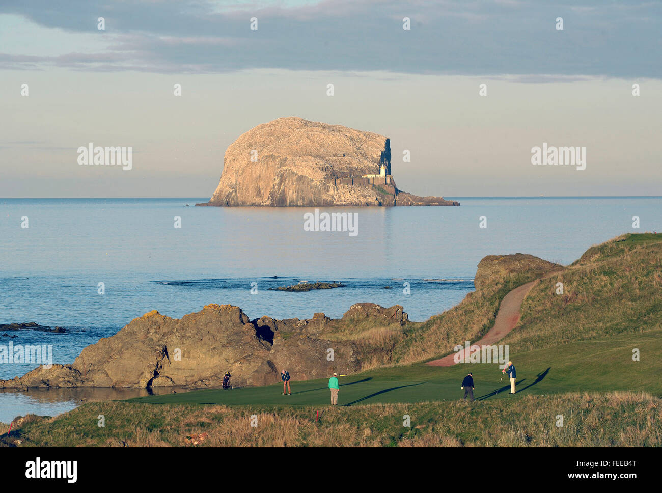 12th October 2014 The Glen Golf course and Bass Rock, North Berwick UK. Golfers on 13th, 'Sea Hole' with - Stock Image