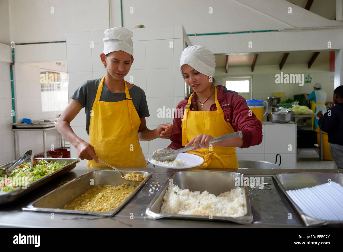Teens at the food counter in a canteen, social project, Bogota, Colombia - Stock Image