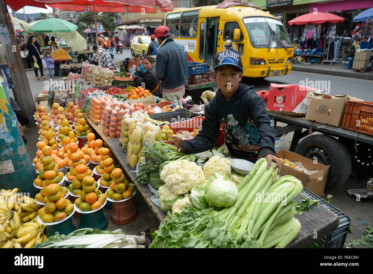 Child labor, boy, 12 years, selling vegetables at a street market, Barrio 20 de Julio, Bogota, Colombia - Stock Image