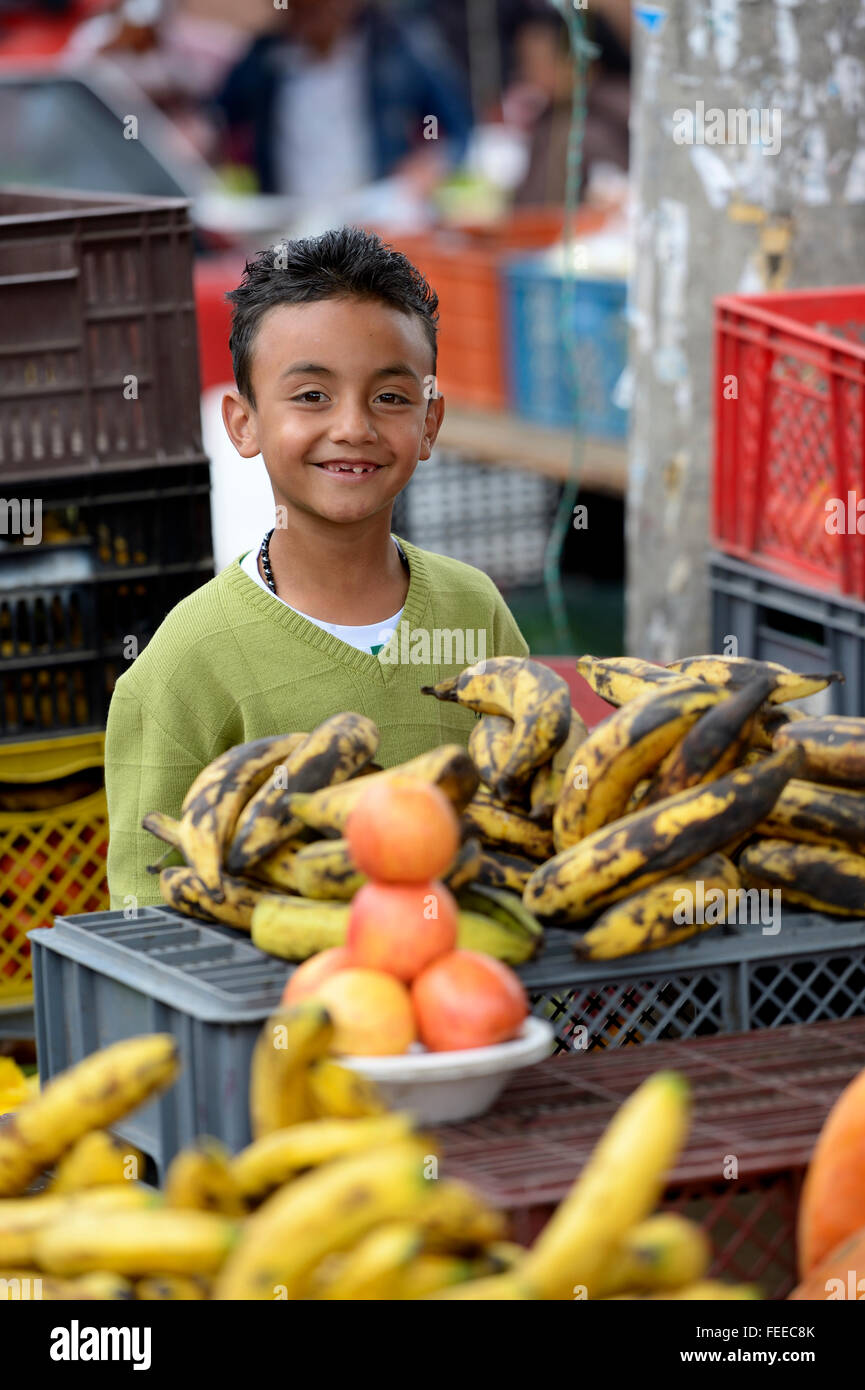 Child labor, boy, 8 years, selling vegetables at a street market, Barrio 20 de Julio, Bogota, Colombia - Stock Image