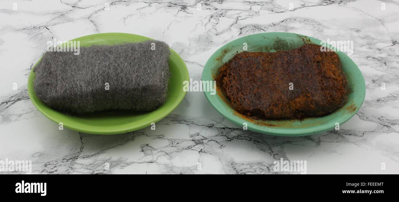 Two steel wool. The left is dried and the right is wet. The wet steel wool shows after a while with rusty appearance. Stock Photo