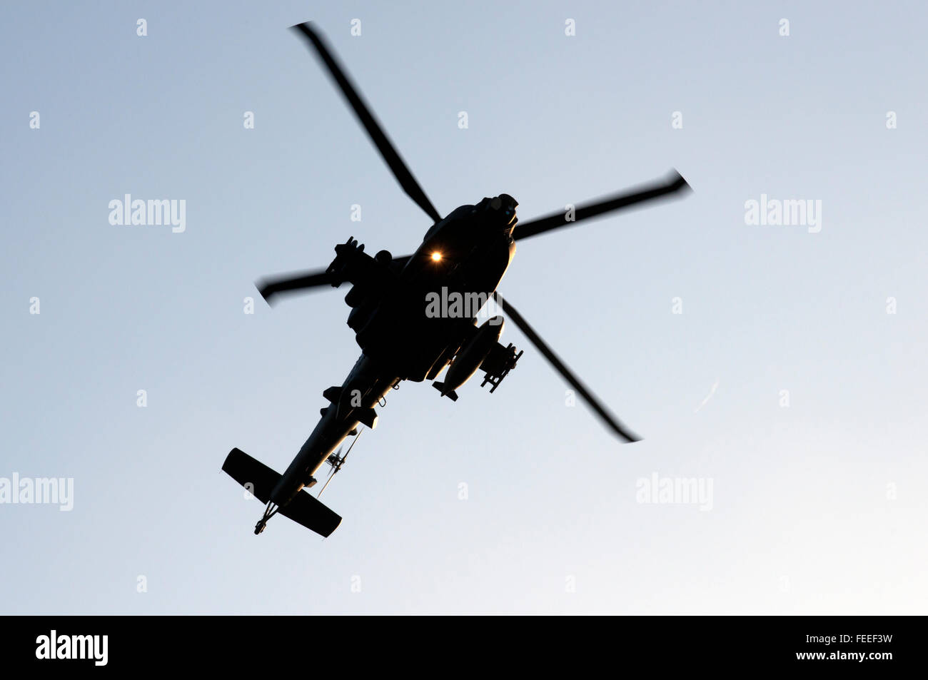 AgustaWestland Apache attack helicopter flying on a training mission over Woodbridge airfield, Suffolk, UK. Stock Photo