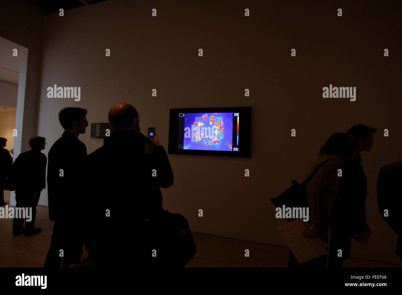 Thermal images of visitors lying on a bed like platform,  are part of the installation of Astro Noise, the first - Stock Image