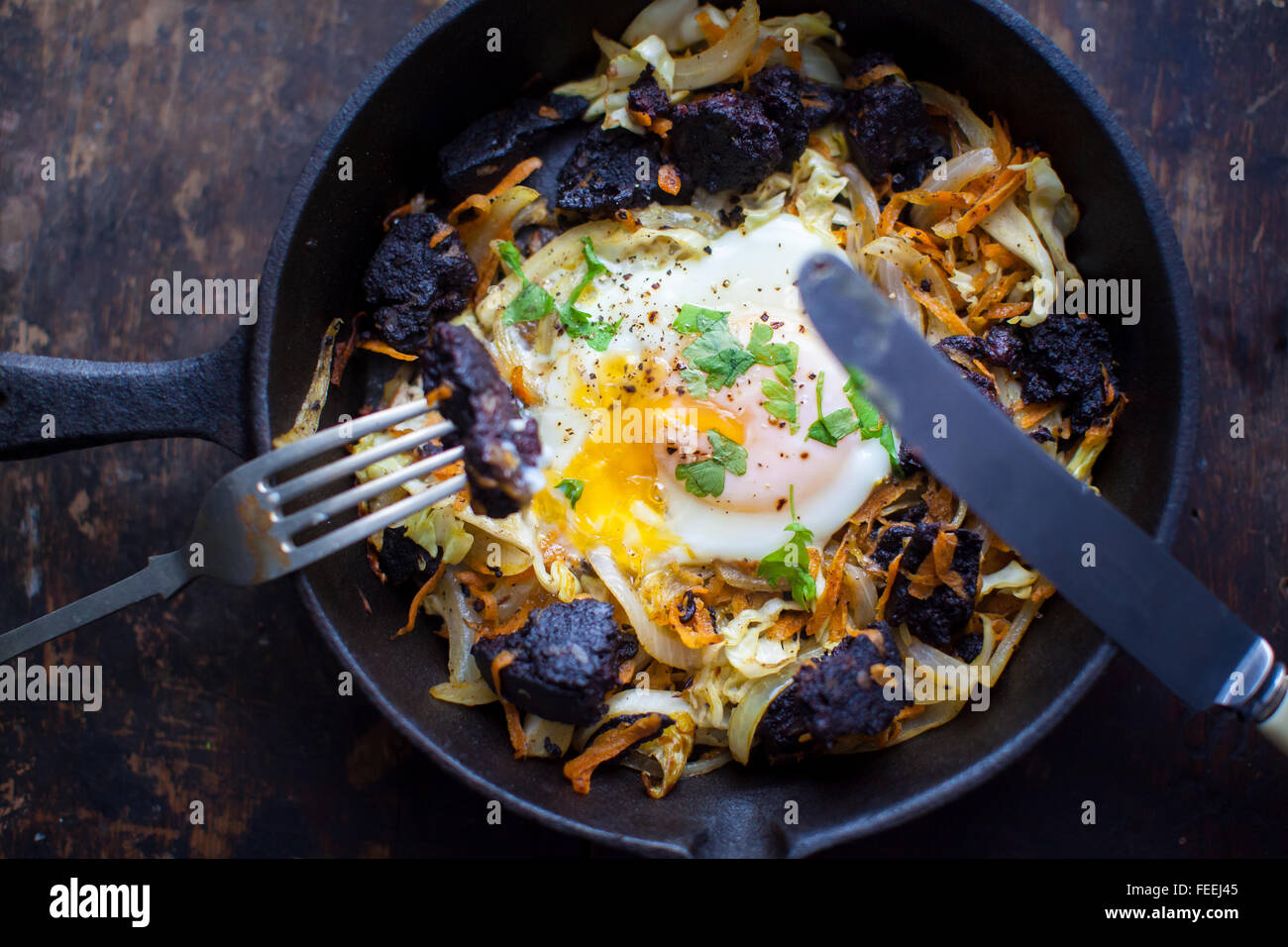 A skillet full of homemade black pudding hash. - Stock Image