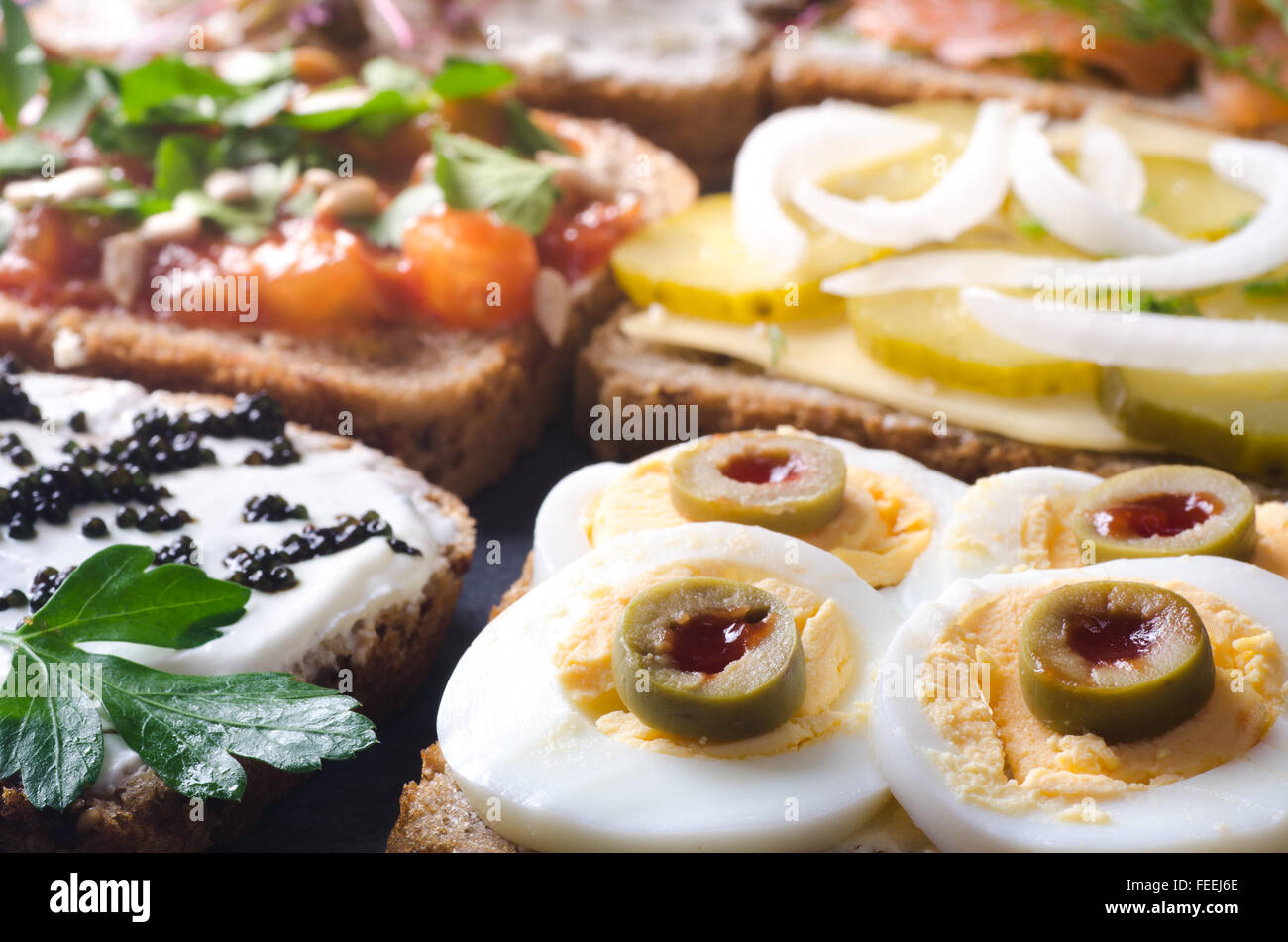 group open sandwiches on table - Stock Image