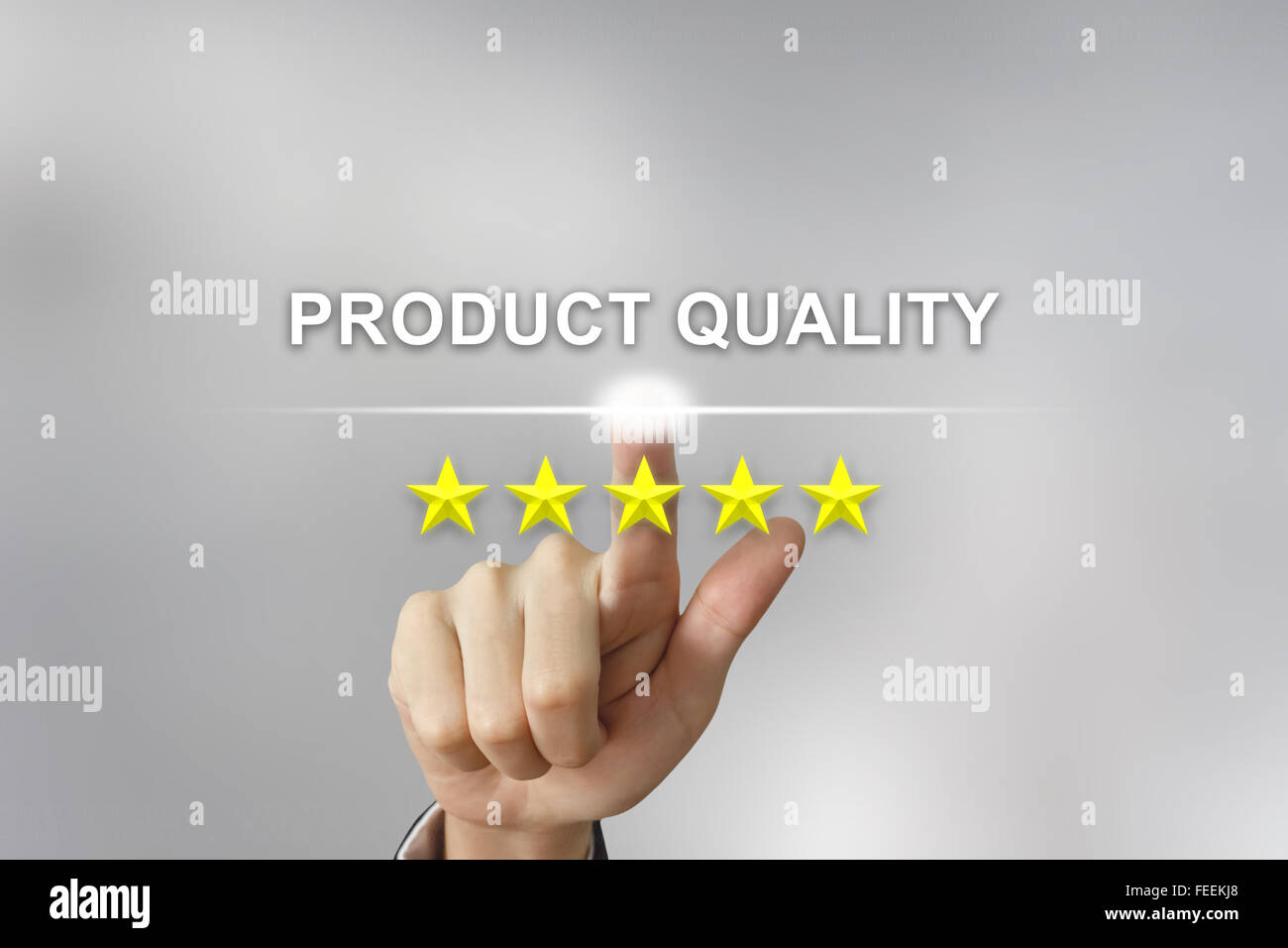 business hand clicking product quality with five stars on screen - Stock Image