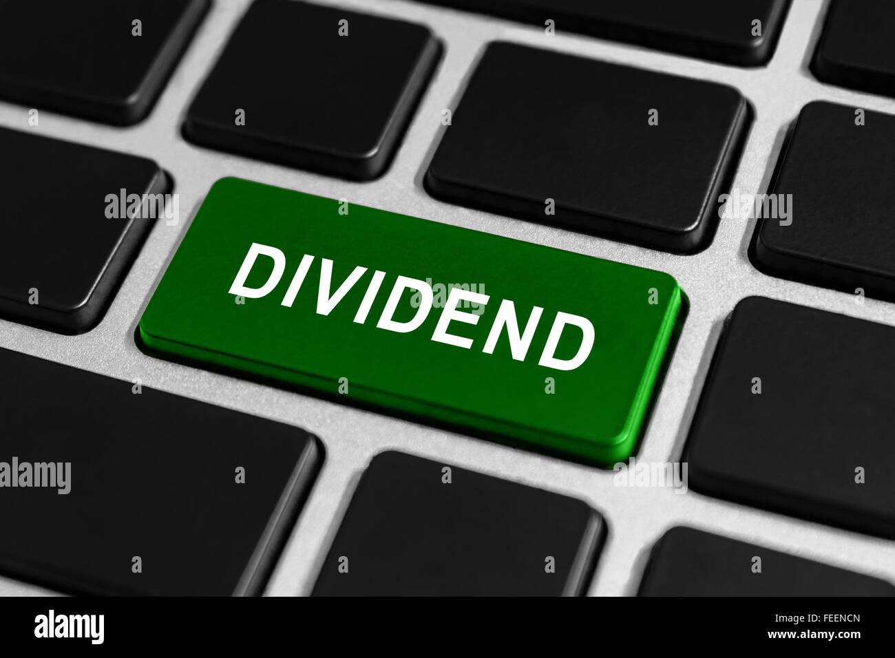 dividend green button on keyboard, business concept - Stock Image