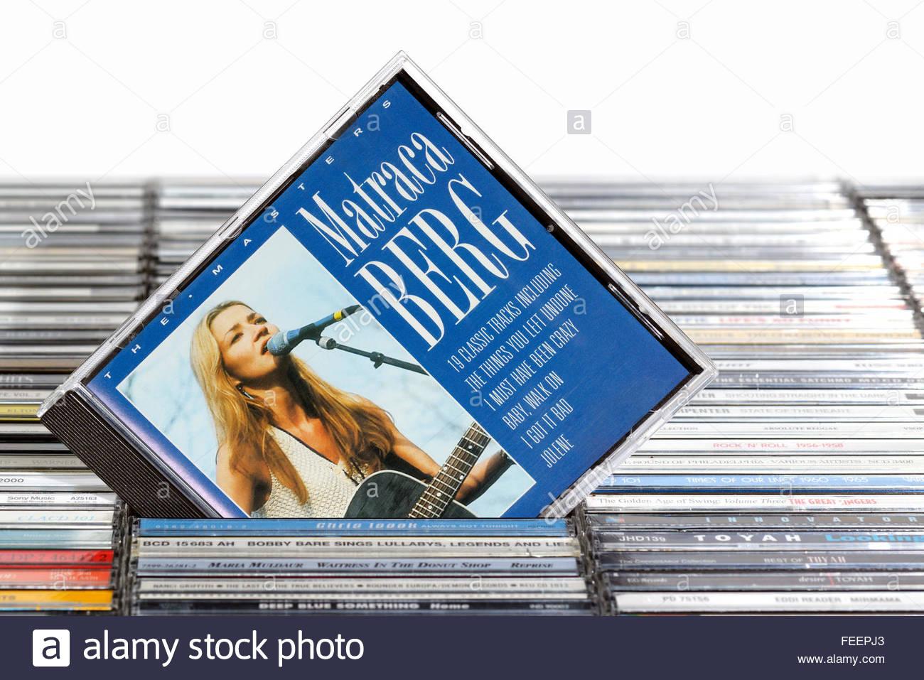 Matraca Berg greatest hits album, piled music CD cases, Dorset England Stock Photo