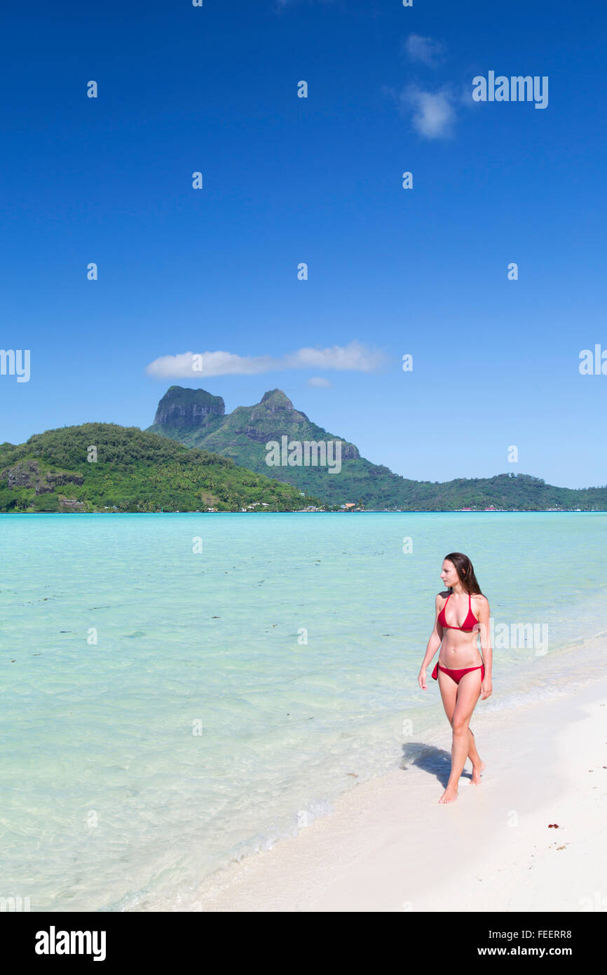 Woman on Motu Tevairoa, Bora Bora, Society Islands, French Polynesia - Stock Image
